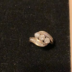 14k gold and diamond ring.